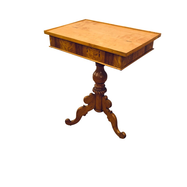 A three-legged pedestal supports is very steady and supports a generous table surface whose faces are adorned with prime bookmatched birch veneers.