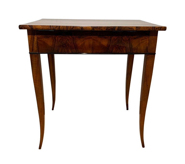 Very elegant, early Biedermeier side table / writing table with drawer from South Germany circa 1820  Walnut veneered at the plate and apron and legs made of walnut solid wood. Shellac hand-polished (French Polished) and partly