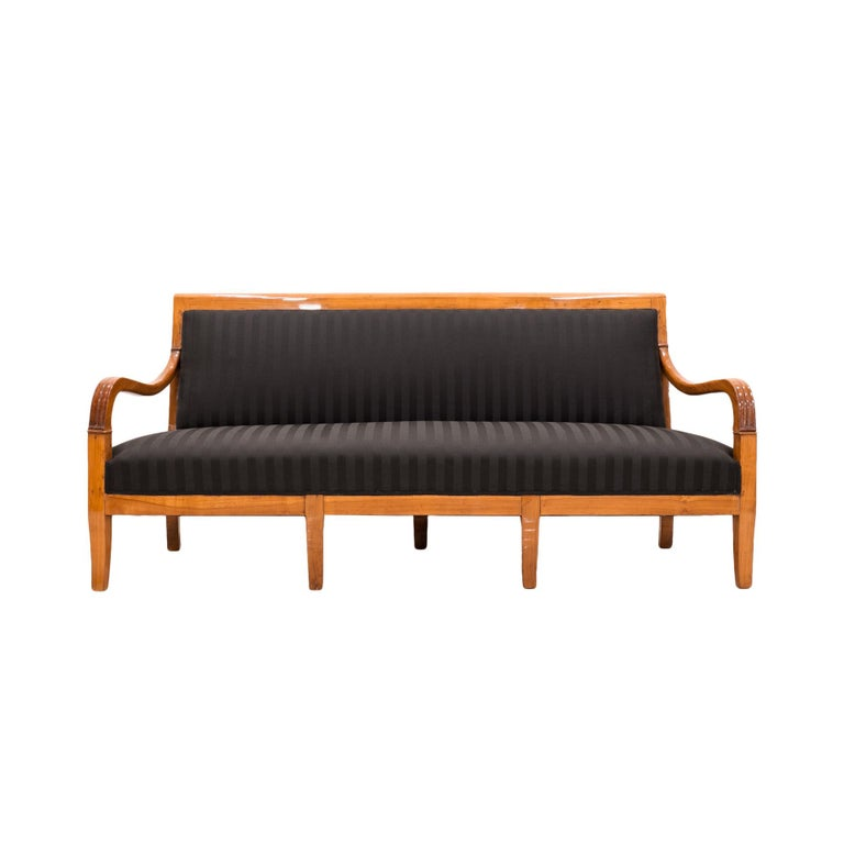 This Biedermeier era sofa comes from France from circa first half of the 19th century. The piece is after complete renovation. It has new seats with springs, covered with top quality upholstery. Wooden base of this piece is made of solid cherrywood.