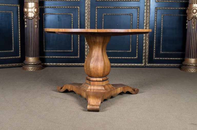 Solid cherrywood and veneered. Inclined, column shaft, flanked by three curly volutes. A strict form of the early Biedermeier period. It is built with a folding mechanism. This type is very practical, not only because it saves space, but because it