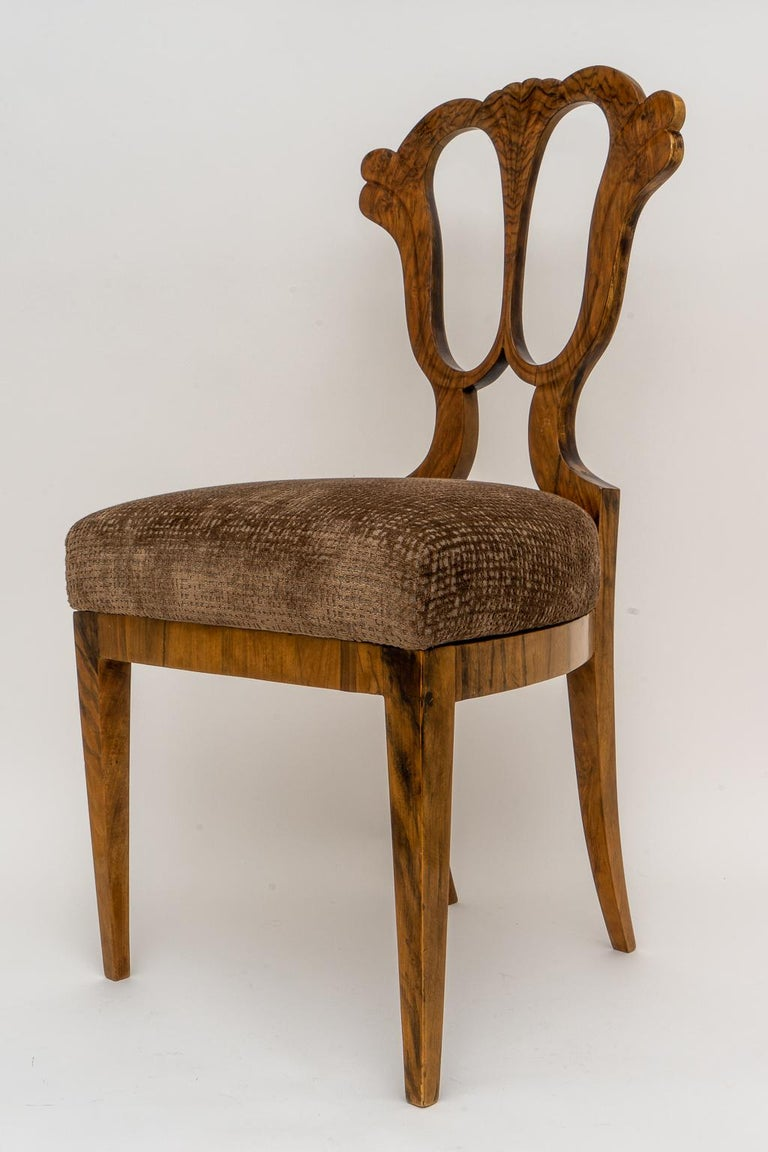 This stylish and chic Biedermeier side chair date to the early part of the 19th century and it's the perfect scale as a desk chair or perhaps as a vanity table chair. The piece retain a label on the underside of the seat for T.Rohan and interior