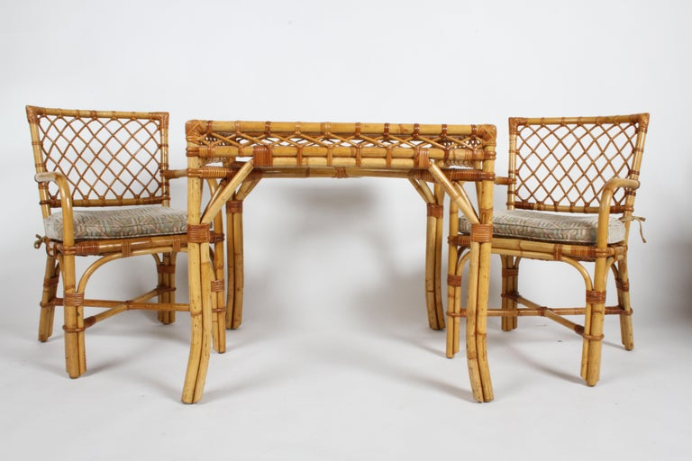 Bielecky Brothers NYC card or dining table set with textured glass top and two armchairs (model #R5319), circa 1980s. In nice vintage condition, minor wear to rattan, glass appears free of chips. Older upholstered seats should be updated. Nice set,