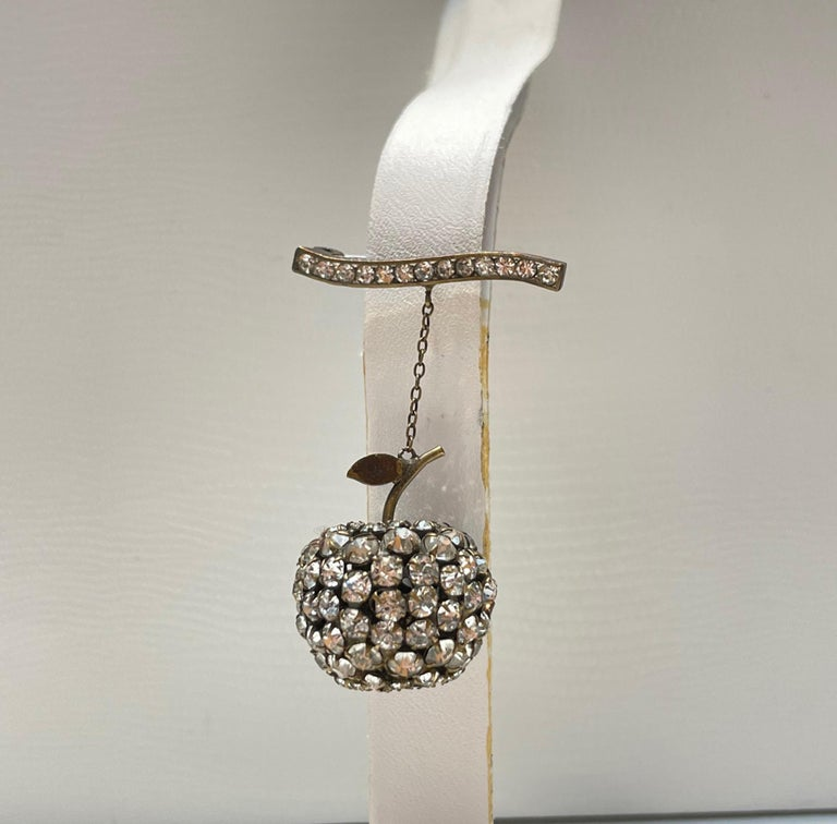 """Beautifully designed Art Deco Brooch featuring an Apple encrusted with Sparkling Crystals suspended from a Crystal encrusted Bar. Silver mounting. Measuring approx. 1.75"""" long. More Beautiful in real time...Chic and sure to be admired complement to"""