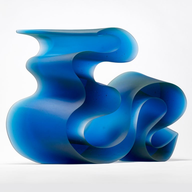 Big blue line is a unique cast glass sculpture in blue glass, created by the Danish artist Karin Mørch. Dramatic sweeping curves Meander and follow the beautiful lines of this heavy and solid cast piece. Mørch intimately understands her glass and