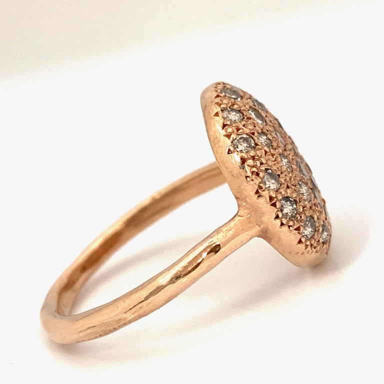 Every cookie is different and delicious, and so are Eytan's Cookie rings!  This one is a gorgeous shade of rose and is faced entirely in tiny beads, which give the gold its distinctive texture and provide tiny braces for 36 bright white melee