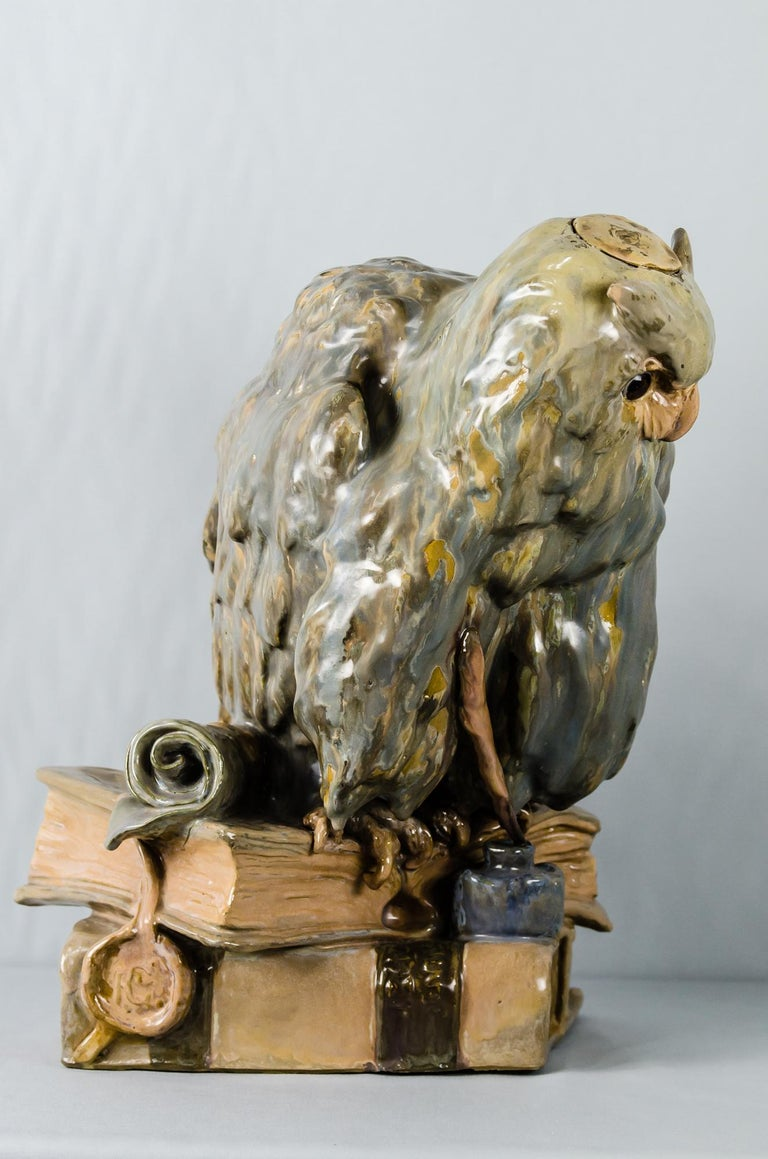 Big Ceramic Golscheider Owl Lamp  Writing on the book shows Reproduction Reservee´ figurative reproductions in stone molding (artificial marble). if there is a bulb inside, that makes the eyes shine. Original condition.