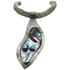Big  Grey Blister Pearl framed in Silver matching Pearl earring  Sylvia Gottwald