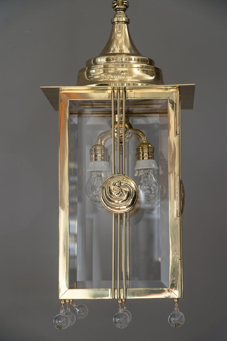 Big Jugendstil pendant with cut glasses, circa 1910s Polished and stove enameled The length of the chandelier is easy adjustable for rooms of differing heights.