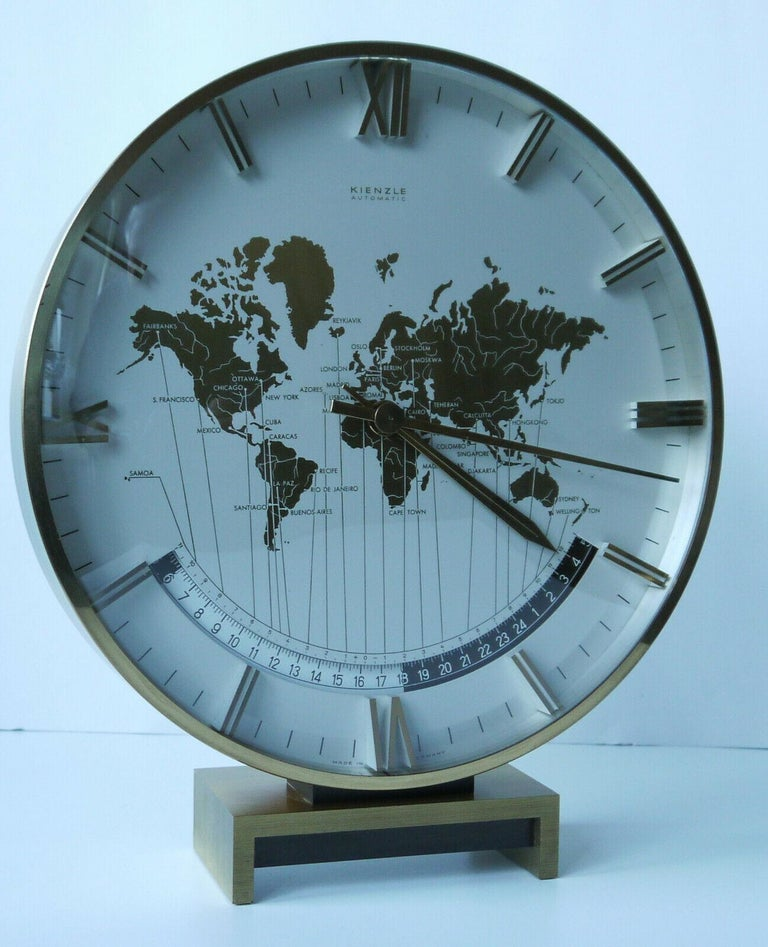 Kienzle automatic world timer zone clock. An exclusive big table clock from Ø 26 cm wonderful clocks face with world map and world time zones, glass, the heavy case & base are of solid brass. Battery movement. The most of Kienzle clocks were