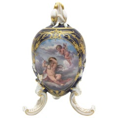 Big KPM Berlin Porcelain Egg on 3 Feet in Cobalt Blue with Rich Gold Painting