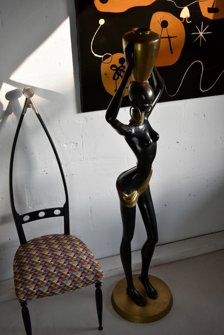 Beautiful, elegant and stylish. Bronze with black and golden patina, gilded brass. African Mid-Century Modern human size beauty. Made after the African neck stretching tribe known as