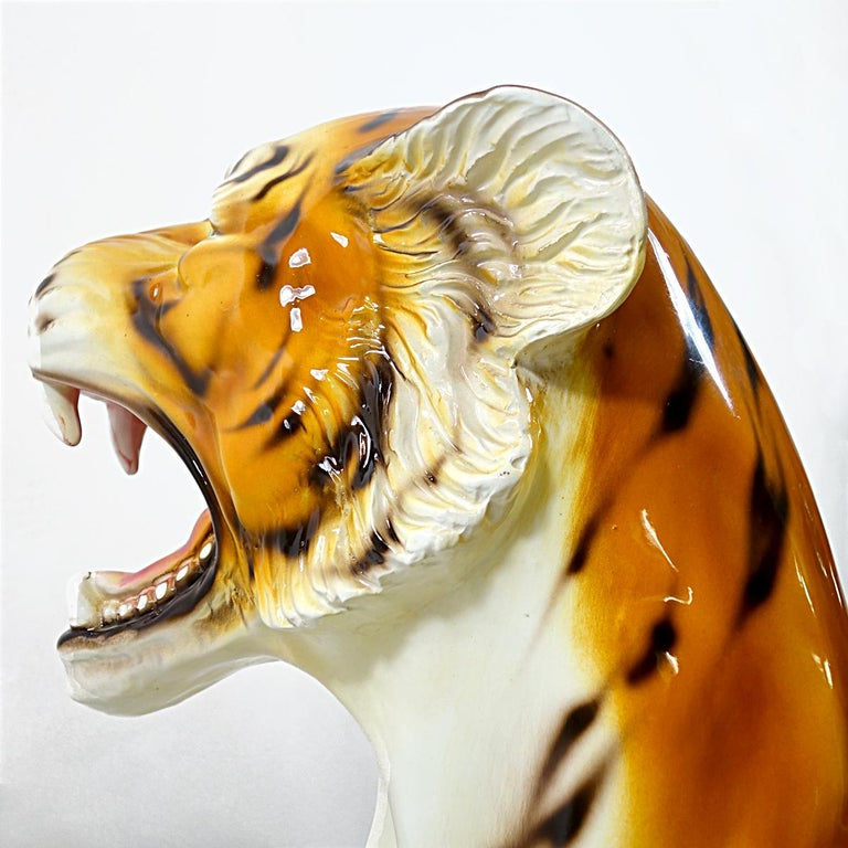 Very big statuette of a sitting tiger made of ceramic. It is almost one meter (approx. three feet) high.