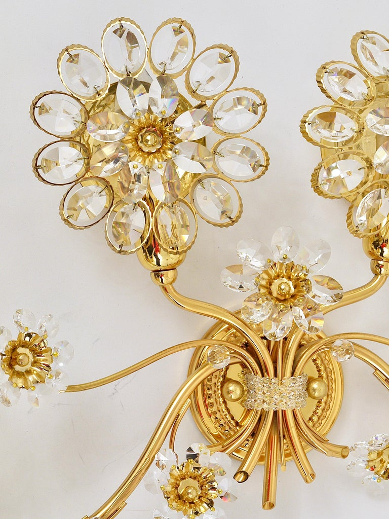 A beautiful and huge floral sconce, manufactured in the 1970s by Palwa, Germany. Made of gold-plated brass with faceted crystal glass petals. In excellent condition. We offer other matching Palwa sconces and chandeliers in our other listings.