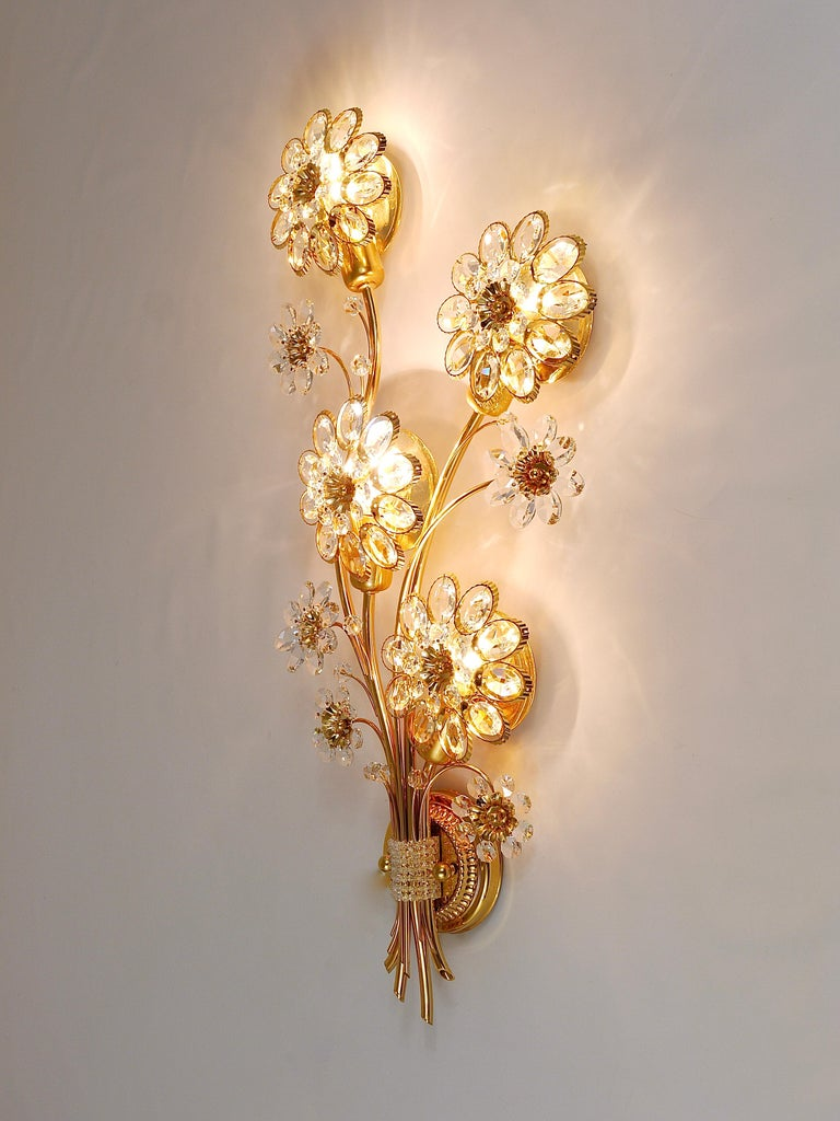 A beautiful and huge floral sconce, manufactured in the 1970s by Palwa, Germany. Made of gold-plated brass with faceted crystal glass petals. In excellent condition.