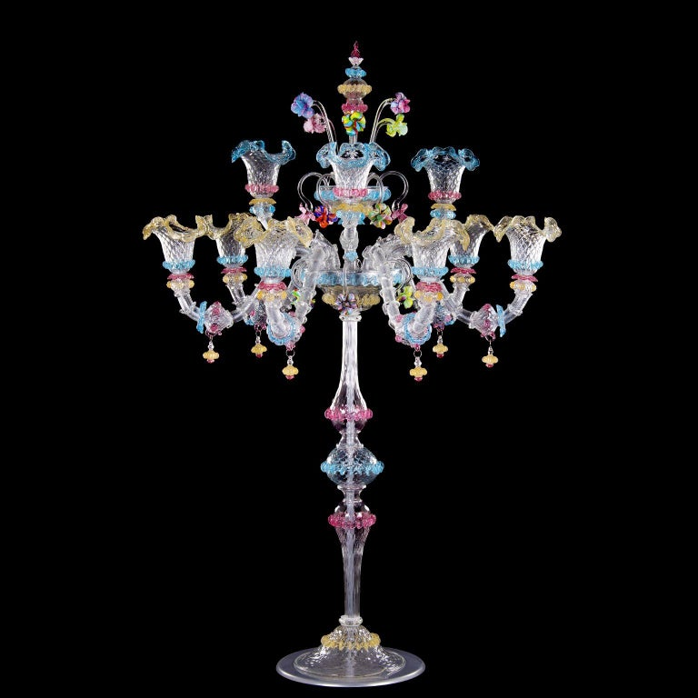Big luxury rezzonico flambeau 6+3 arms, crystal Murano glass, rich of multi-color details nickel structure by Multiforme. This artistic table lamp is an elegant and delicate lighting work, colored with pastel tones. The structure is a combination of