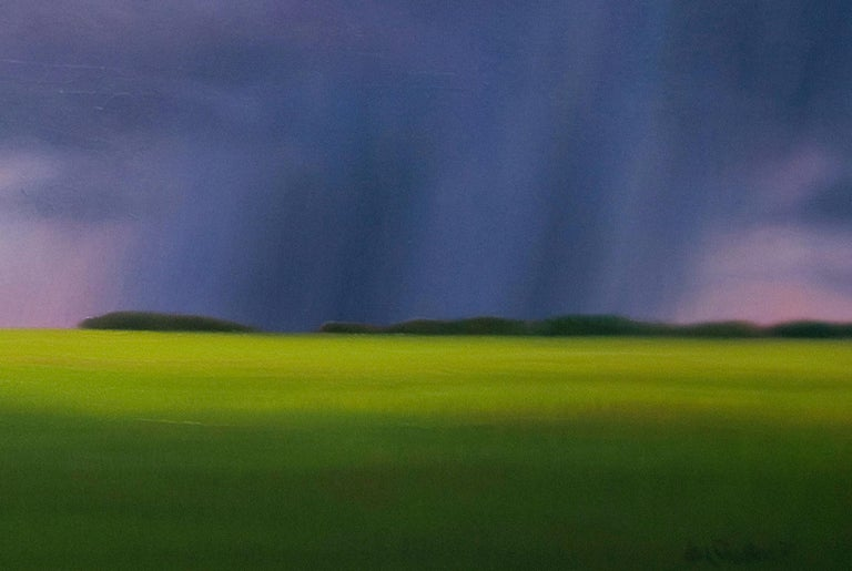 The high contrasts of a deep blue storm with the green horizon of seemingly limitless prairie anchor the composition of this painting, inspired by a storm in central Alberta. The format of the canvas permits me to study the layers of clouds above
