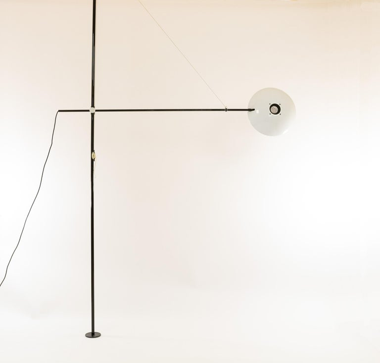 Fully adjustable Bigo floor to ceiling lamp by S.T. Valenti for Italian manufacturer Valenti Luci, 1981  Bigo is a halogen floor lamp equipped with a system of telescopic tubes to enable the column to be fixed between ceiling and floor. The total