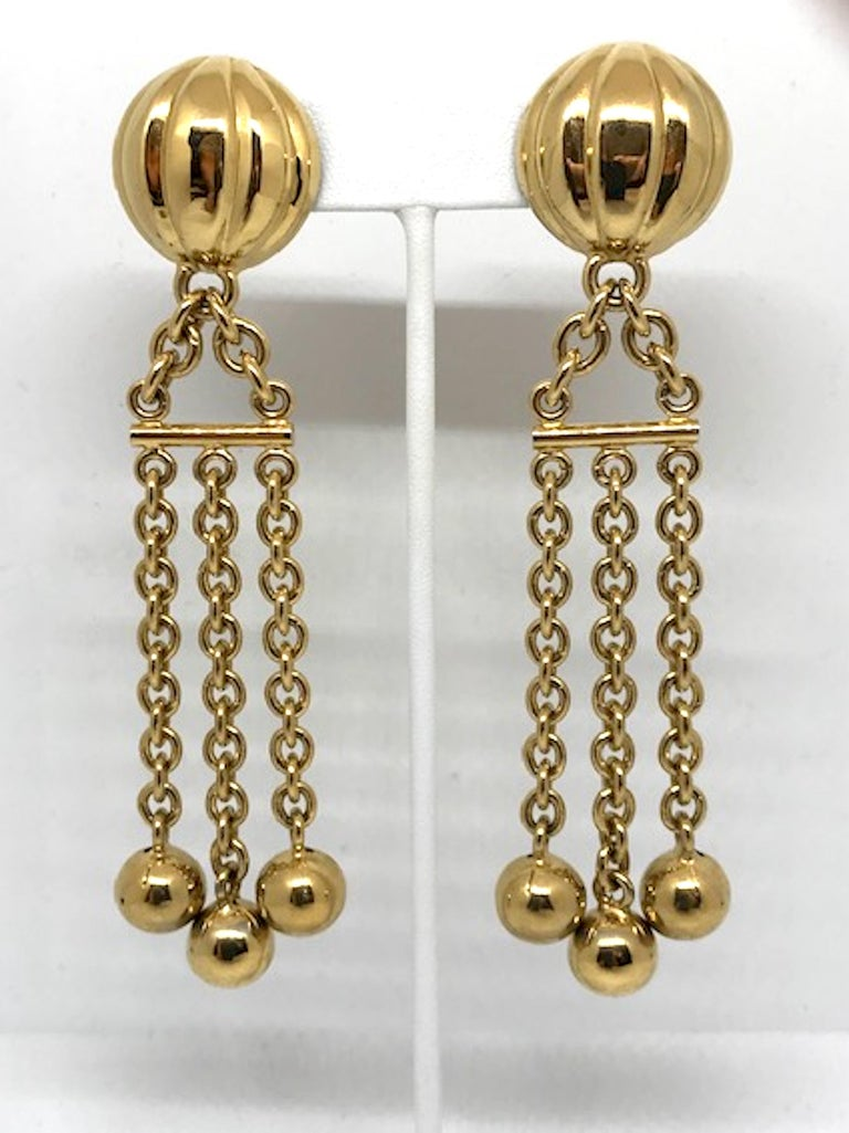 A lovely pair of 1980s gold plate chain with bead fringe earrings from Italian fashion company Bijoux Cascio. Bijoux Cascio jewelry company began in 1948 by Gaetano Cascio in Firenze Italy. This prestigious costume jewelry house created lines of
