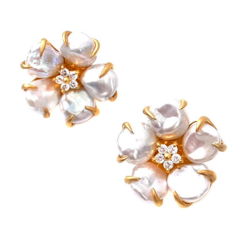 Bijoux Num Baroque Pearl Flower Earrings  These beautiful flower earrings features lustrous baroque pearls as petal and round faux diamond center, handset in 18k gold vermeil sterling silver, and brush satin finish.  Very comfortable post-clip omega