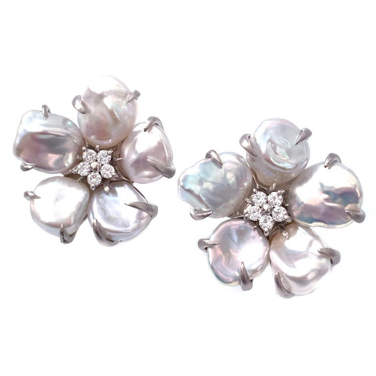Bijoux Num Baroque Pearl Flower Earrings  These beautiful flower earrings features lustrous baroque pearls as petal and round faux diamond center, handset in platinum rhodium plated sterling silver, and brush satin finish.  Very comfortable
