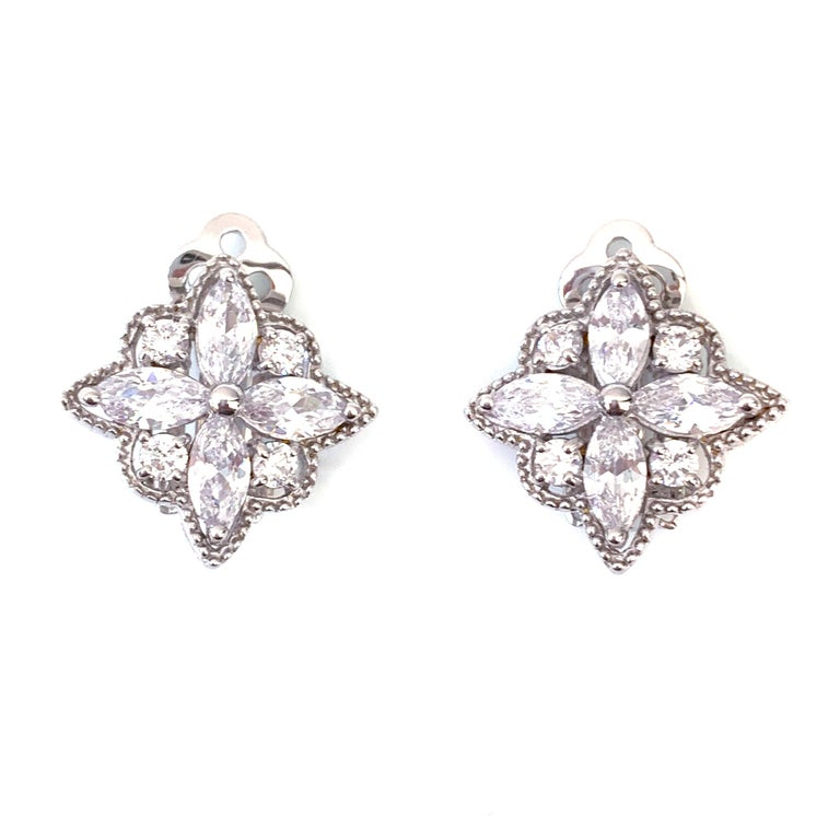 Byzantine Flower Faux Diamond CZ Clip-on Earrings  These earrings feature top quality marquis and round faux diamond cubic zirconia, handset in platinum rhodium plated sterling silver, and adorned with beaded trim. The earrings measure approximately