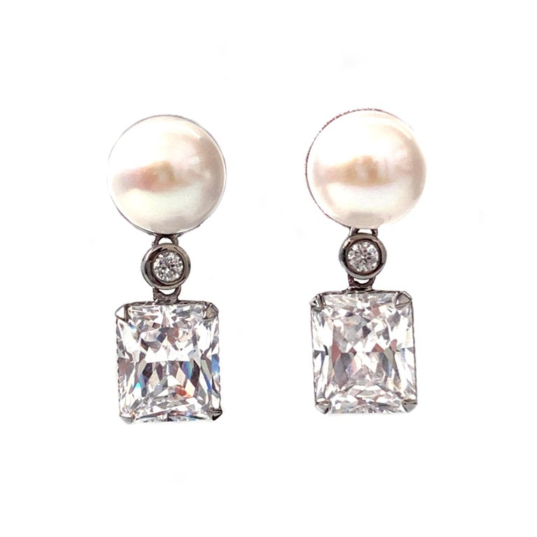 Bijoux Num Cultured Pearl and Faux Diamond Drop Earrings  Stunning runway style earrings feature 11mm white cultured pearl and octagon faux diamond (4 carat size), handcrafted in black rhodium plated sterling silver. The earrings give a lot of