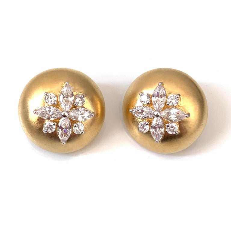 Bijoux Num Flower Faux Diamond Round Button Clip-on Earrings.  The earrings features top quality marquis and round faux diamond cubic zirconia, handset in 18k gold vermeil sterling silver, and brush satin finished.  Very comfortable clip back.