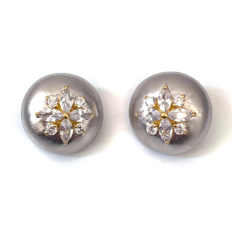 Bijoux Num Flower Faux Diamond Round Button Clip-on Earrings.  The earrings features top quality marquis and round faux diamond cubic zirconia, handset in platinum rhodium and 18k gold two tone plated sterling silver, and brush satin finished.  Very
