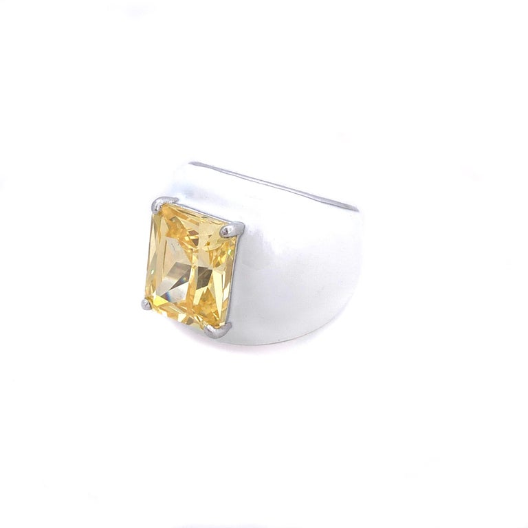 Bijoux Num Faux Canary Diamond White Enamel Bombe Dome Ring  This bold cocktail ring features beautiful top quality 6.5ct radiant-cut faux canary diamond cubic zirconia, handset in platinum rhodium plated sterling silver. The entire ring is sheathed
