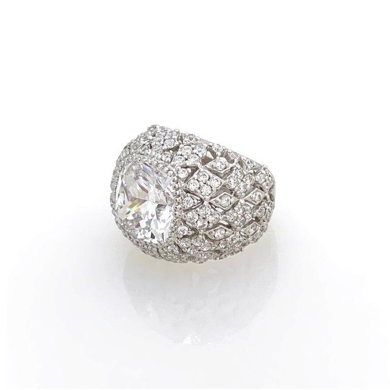Bijoux Num Sterling Silver Faux Diamond Bombe Dome Ring  This bold cocktail ring features beautiful top quality 5ct cushion-cut faux diamond cubic zirconia, surrounded with 136 round faux diamonds, handset in platinum rhodium plated sterling silver.