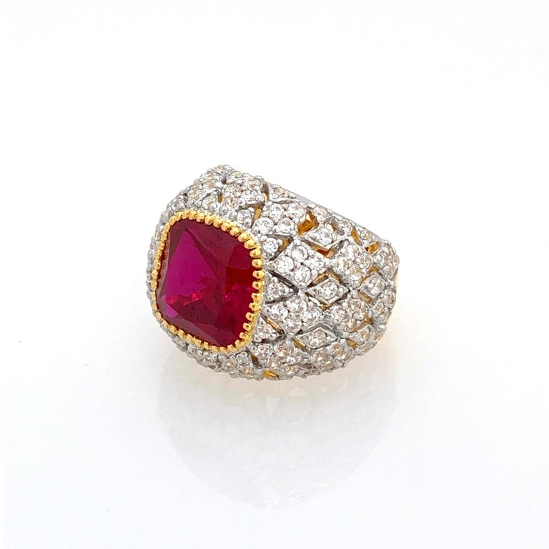 Bijoux Num Sterling Silver Lab Ruby Bombe Dome Ring  This bold cocktail ring features beautiful top quality 5ct cushion-cut lab created ruby, surrounded with 136 round faux diamonds, handset in 18k gold vermeil with platinum rhodium over sterling