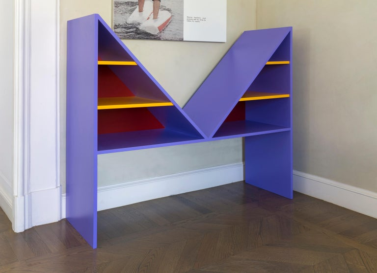 Bikini Collection celebrating French designer Louis Réard who invented the two-piece bathing suit, this sculptural bookcase is distinctive for the strong visual impact of the M-shaped silhouette and vibrant colors. Made entirely of wood, the piece
