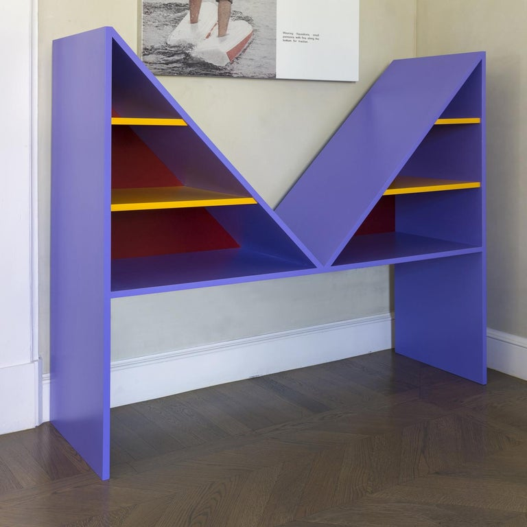 Part of the Bikini collection celebrating French designer Louis Réard who invented the two-piece bathing suit, this striking bookcase is distinctive for the strong visual impact of the M-shaped Silhouette and vibrant colors. Made entirely of wood,