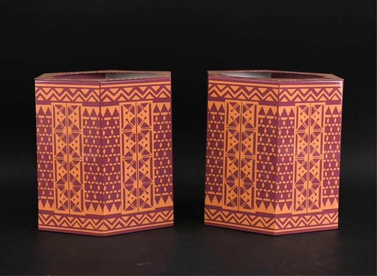 A funky pair of metal planters with op-art screen printed designs by artist Bill Bell.