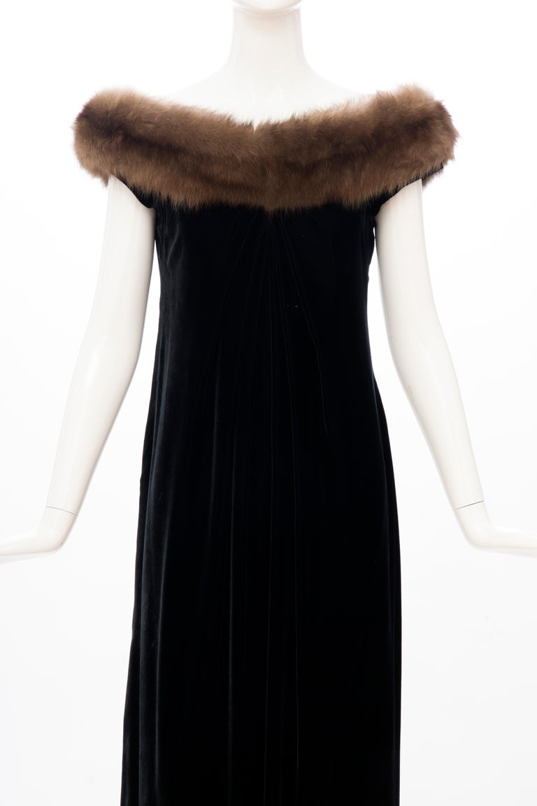 Bill Blass, Fall 1984, black silk velvet draped evening dress with off-shoulder sable neckline, concealed back zip and hook-and-eye closure and fully lined in black silk.  Documented: Bill Blass - An American Designer - Harry N. Abrams, Inc.,