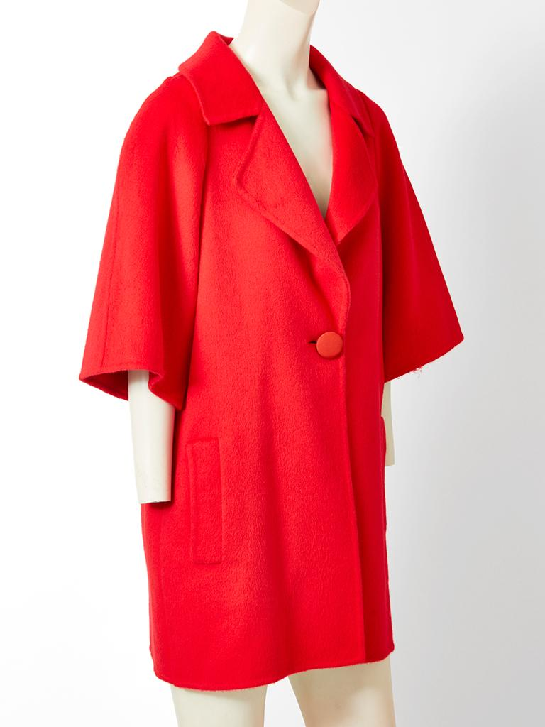 Bill Blass, red, double face, cashmere, coat having 3/4 sleeves, a notched collar, a single button closure  and back smocking detail.