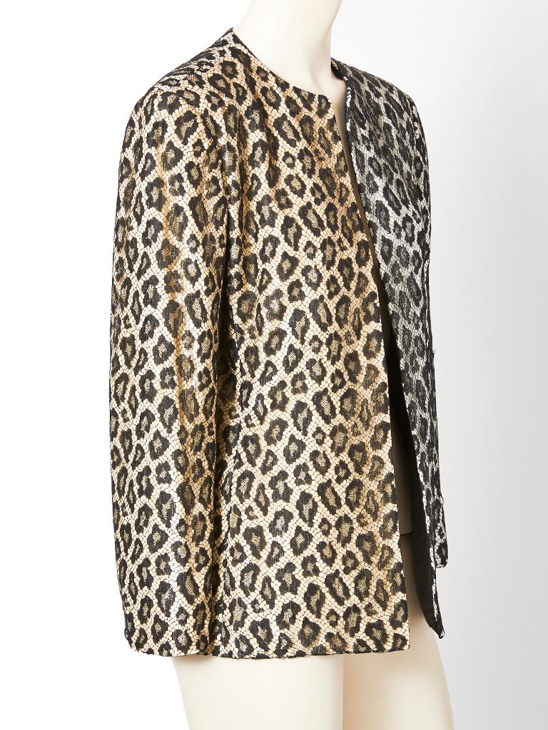 Bill Blass cardigan/evening jacket made of a lace leopard pattern overlayer sitting on an entirely sequined underlayer, Including  the sleeves. The visual results are very subtle forcing you to look closely. The sequins are very small and half of