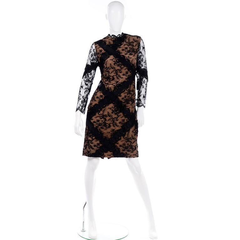 This incredible vintage 1980's Bill Blass evening dress is so elegant with its fine black lace over a feather light silk under dress.. This double layer with a peach or nude silk was commonly used by Mr. Blass during this time. He made some stunning