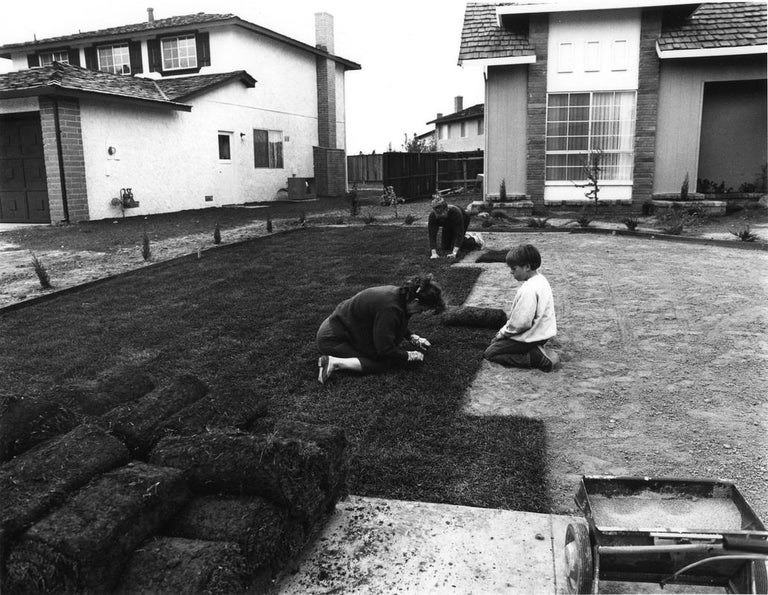 """I bought the lawn in six-foot rolls. It's easy to handle. I prepare the ground and my wife and son helped roll out the grass. in one day you have a front yard."" Edition of 15 Signed, numbered, and artist stamp. Series: Suburbia  Bill Owens was born"