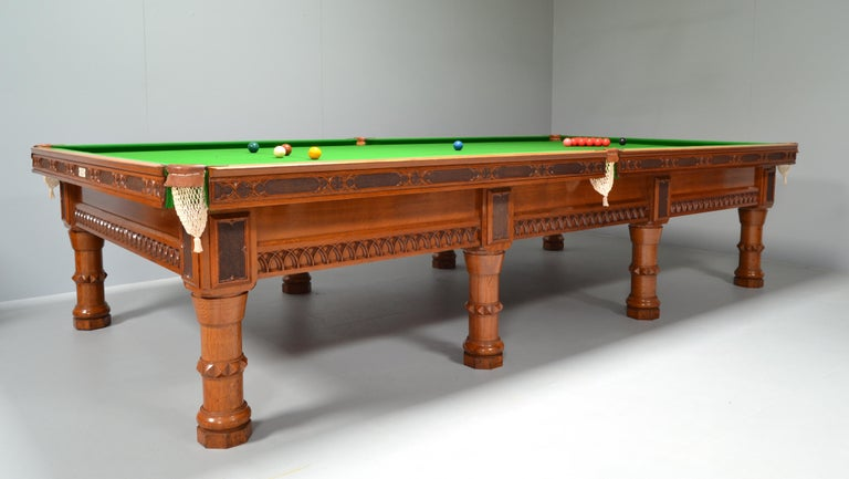 Billiard Snooker gothic revival form antique table by Orme of Manchester circa 1860, an unusual and unique design solid oak construction with tracery decoration to the frame, the cushion edges embellished with stipple carving, supported by eight