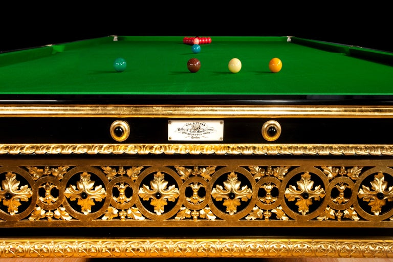 This striking full size (12ft) Billiard table was made for James Blyth, 1st Baron Blyth (1841-1925) for 33 Portland Place, London. It is veneered in ebony with openwork gilt-wood panels applied to the sides and boldly carved and gilded acanthus leaf