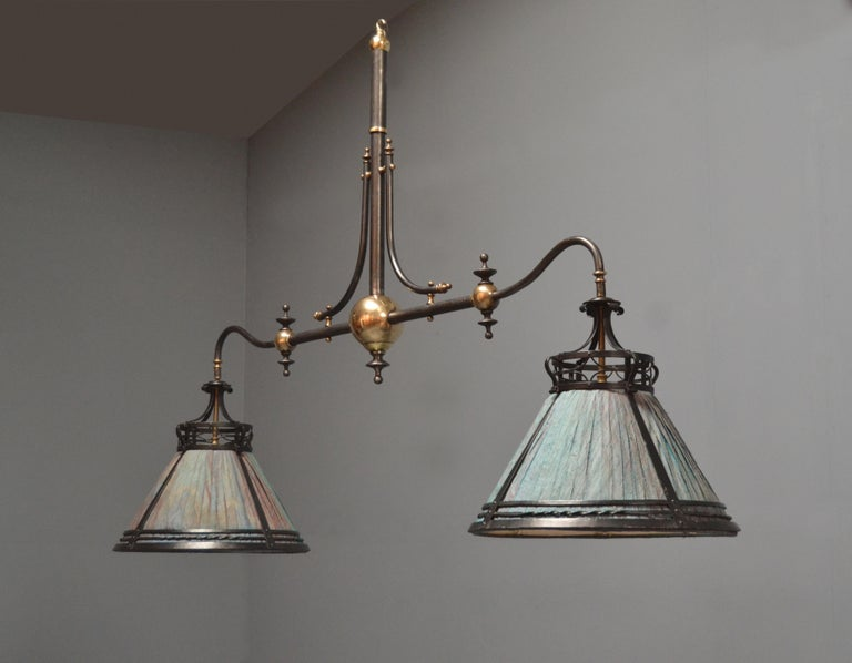 A unique antique handmade steel framed Billiard - Snooker light of Arts & Crafts style circa 1910, curved arms with adjoining braces, brass finials and ball joins, complete with two original circular pierced decorative steel silk shades.