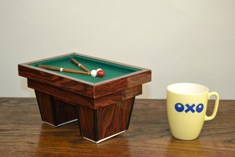 Billiard table - game table - pool table. This great miniature billiard game table with billiard cues and billiard-balls is a perfect object to put in a lighted showcase, a great gift for a billiard player or billiard club, or to be placed in an