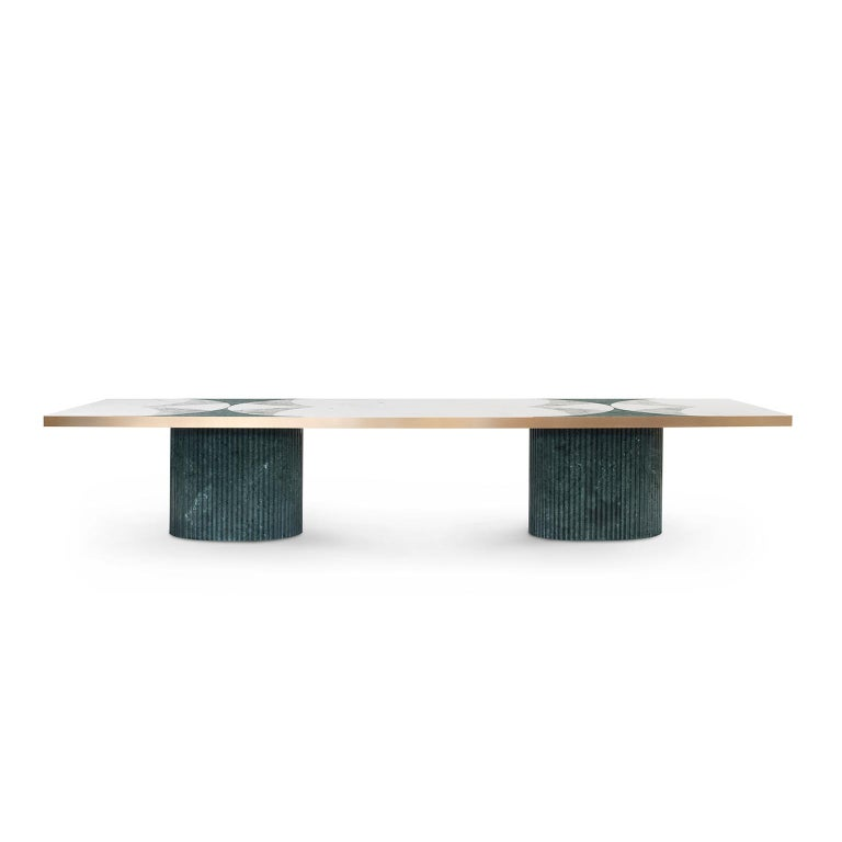 Wooden dining table with top in four marble inlaid composition: Green Guatemala, Rosa Egeo, Verde Antigua and Calacatta Cremo. Tabletop border in brushed brass high gloss finish. Base in polished green Guatemala marble.