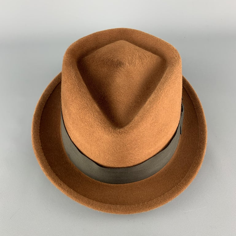 BILTMORE fedora comes in tan brushed felt with a diamond crown and black ribbon trim. Made in Canada.  Excellent Pre-Owned Condition. Marked: 6 7/8  55  Measurements:  Opening: 22.5 in. Brim: 1.25 in. Height: 3.5 in.
