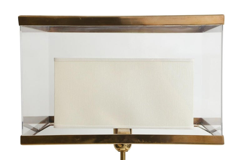 Transparent Binario lamp with brass accents and base.   Measures: With shade 10.5