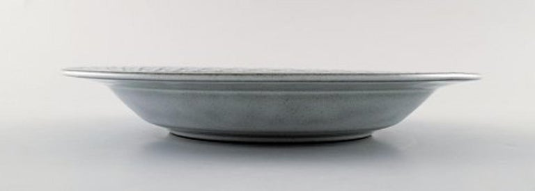 Bing & Grondahl number 322. Set of 7 deep plates. B & G Grey Cordial Quistgaard Nissen Kronjyden stoneware. Measures: 21.2 cm. Height 3 cm. In perfect condition. Stamped Kronjyden or Bing & Grondahl Copenhagen Stoneware: Designed for Kronjyden