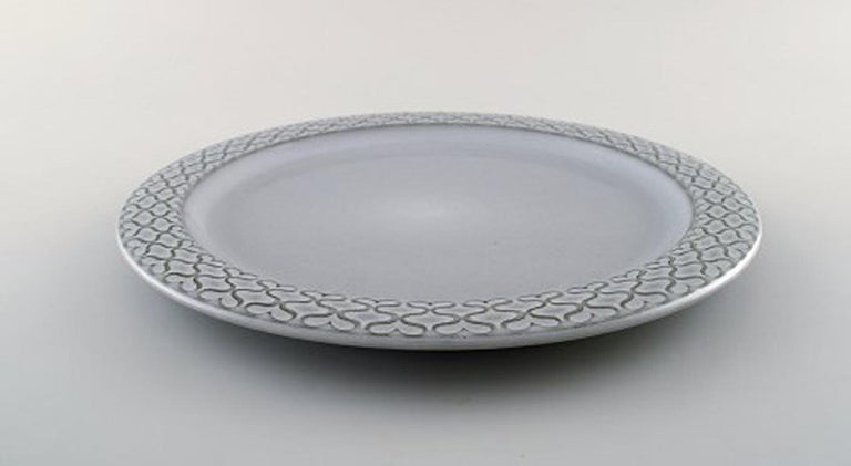 Bing & Grondahl number 624. Set of 10 dinner plates. B & G Grey Cordial Quistgaard Nissen Kronjyden stoneware. Measures: 26 cm. In perfect condition. Stamped Kronjyden or Bing & Grondahl Copenhagen Stoneware: Designed for Kronjyden Nissen Jens