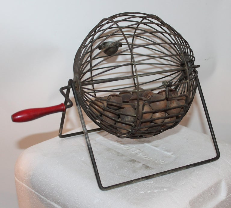 This cool early wire roller has the embossed numbers on the wood balls and in fine working condition. It is the natural wood balls with numbers on them.