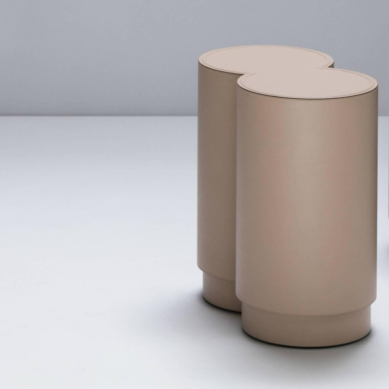 The Binity stool is a leather covered stool designed by Stéphane Parmentier for the Italian leather specialist Giobagnara. The key to this piece elegance is an absolute precision of proportion. The shape has the timeless allure of Art Deco. Here